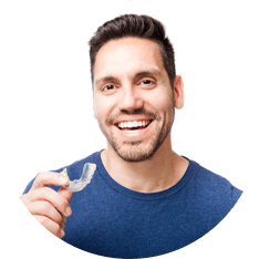 man inserting his clear aligners